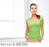 Купить «smiling young woman in blank green t-shirt», фото № 6300543, снято 1 июня 2013 г. (c) Syda Productions / Фотобанк Лори
