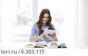 Купить «Smiling student girl with tablet pc and books», видеоролик № 6303115, снято 11 марта 2014 г. (c) Syda Productions / Фотобанк Лори