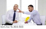 Купить «Two smiling businessmen or architects in office», видеоролик № 6303503, снято 11 июня 2014 г. (c) Syda Productions / Фотобанк Лори