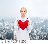 Купить «smiling female doctor with heart and stethoscope», фото № 6317255, снято 15 апреля 2014 г. (c) Syda Productions / Фотобанк Лори