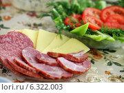 Сыры, колбасы и овощной салат на праздничном столе. Стоковое фото, фотограф Манапова Екатерина / Фотобанк Лори