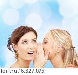 Купить «two smiling young women whispering gossip», фото № 6327075, снято 29 сентября 2007 г. (c) Syda Productions / Фотобанк Лори