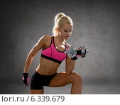 Купить «sporty woman with heavy steel dumbbells», фото № 6339679, снято 8 мая 2014 г. (c) Syda Productions / Фотобанк Лори