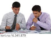 Купить «Businessmen with a calculator», фото № 6341879, снято 31 мая 2011 г. (c) Phovoir Images / Фотобанк Лори
