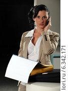 Купить «Woman at the office», фото № 6342171, снято 4 мая 2011 г. (c) Phovoir Images / Фотобанк Лори