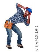 Купить «A traumatized tradesman», фото № 6342643, снято 10 мая 2011 г. (c) Phovoir Images / Фотобанк Лори