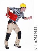 Купить «Builder stood in running position», фото № 6344831, снято 28 апреля 2011 г. (c) Phovoir Images / Фотобанк Лори