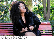 Купить «Young beautiful woman siting on bench in park», фото № 6372127, снято 12 июля 2020 г. (c) Ingram Publishing / Фотобанк Лори