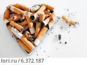 Купить «Cigarette stubs in a metal heart shaped ashtray», фото № 6372187, снято 12 декабря 2018 г. (c) Ingram Publishing / Фотобанк Лори