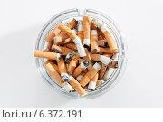 Купить «Overhead view of glass ashtray full of cigarette stubs», фото № 6372191, снято 12 декабря 2018 г. (c) Ingram Publishing / Фотобанк Лори