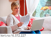 Купить «Woman sitting at home with laptop looking worried at camera while holding a bill», фото № 6372227, снято 4 августа 2020 г. (c) Ingram Publishing / Фотобанк Лори