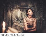 Купить «Tattooed beautiful woman in old spooky interior», фото № 6378743, снято 19 июля 2014 г. (c) Andrejs Pidjass / Фотобанк Лори