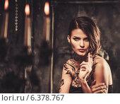 Купить «Smoking tattooed beautiful woman in old spooky interior», фото № 6378767, снято 19 июля 2014 г. (c) Andrejs Pidjass / Фотобанк Лори