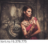 Купить «Smoking tattooed beautiful woman in old spooky interior», фото № 6378775, снято 19 июля 2014 г. (c) Andrejs Pidjass / Фотобанк Лори