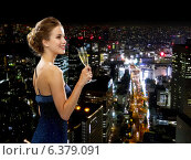 Купить «smiling woman holding glass of sparkling wine», фото № 6379091, снято 1 июня 2014 г. (c) Syda Productions / Фотобанк Лори