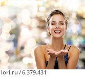 Купить «laughing woman in evening dress holding something», фото № 6379431, снято 1 июня 2014 г. (c) Syda Productions / Фотобанк Лори