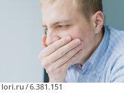 Купить «A man yawns», фото № 6381151, снято 21 ноября 2013 г. (c) Ingram Publishing / Фотобанк Лори