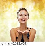 Купить «laughing woman in evening dress holding something», фото № 6392659, снято 1 июня 2014 г. (c) Syda Productions / Фотобанк Лори