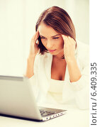 Купить «businesswoman with laptop in office», фото № 6409335, снято 18 июля 2013 г. (c) Syda Productions / Фотобанк Лори