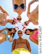 Купить «smiling friends in circle on summer beach», фото № 6412667, снято 3 августа 2014 г. (c) Syda Productions / Фотобанк Лори