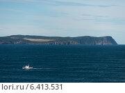 Fishing trawler in the ocean, Cape Spear, St. John's, Newfoundland And Labrador, Canada (2013 год). Стоковое фото, агентство Ingram Publishing / Фотобанк Лори