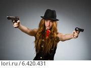 Купить «Woman gangster with gun in hand», фото № 6420431, снято 2 августа 2014 г. (c) Elnur / Фотобанк Лори