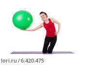 Купить «Young woman exercising with swiss ball», фото № 6420475, снято 11 января 2013 г. (c) Elnur / Фотобанк Лори