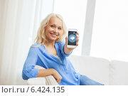 Купить «smiling woman with smartphone at home», фото № 6424135, снято 6 февраля 2014 г. (c) Syda Productions / Фотобанк Лори