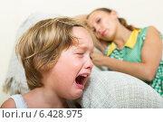 Купить «Crying child and mother at home», фото № 6428975, снято 14 июля 2019 г. (c) Яков Филимонов / Фотобанк Лори