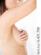 Купить «woman checking breast for signs of cancer», фото № 6431799, снято 25 июля 2013 г. (c) Syda Productions / Фотобанк Лори