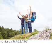 Купить «group of smiling friends with backpacks hiking», фото № 6432167, снято 31 августа 2014 г. (c) Syda Productions / Фотобанк Лори
