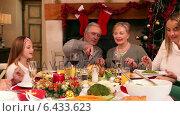 Купить «Three generation family having christmas dinner together», видеоролик № 6433623, снято 22 июля 2019 г. (c) Wavebreak Media / Фотобанк Лори