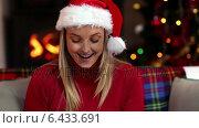 Купить «Pretty blonde opening a christmas gift», видеоролик № 6433691, снято 4 августа 2020 г. (c) Wavebreak Media / Фотобанк Лори