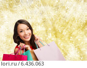 Купить «smiling young woman with shopping bags», фото № 6436063, снято 22 сентября 2013 г. (c) Syda Productions / Фотобанк Лори