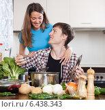 Купить «Young man and woman cooking with soup», фото № 6438343, снято 12 марта 2014 г. (c) Яков Филимонов / Фотобанк Лори