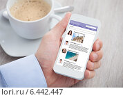 Купить «Businessman Surfing Social Networking Site On Mobilephone», фото № 6442447, снято 25 марта 2014 г. (c) Андрей Попов / Фотобанк Лори