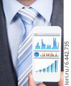 Купить «Businessman Showing Graphs On Smartphone», фото № 6442735, снято 25 марта 2014 г. (c) Андрей Попов / Фотобанк Лори