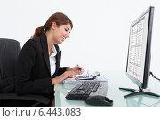 Купить «Businesswoman Calculating Bills At Desk», фото № 6443083, снято 18 мая 2014 г. (c) Андрей Попов / Фотобанк Лори
