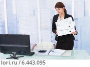 Купить «Businesswoman Carrying Binders In Office», фото № 6443095, снято 18 мая 2014 г. (c) Андрей Попов / Фотобанк Лори