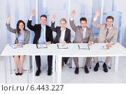 Купить «Personnel Officers Sitting With Hands Raised At Table», фото № 6443227, снято 1 июня 2014 г. (c) Андрей Попов / Фотобанк Лори