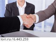 Купить «Businessmen Shaking Hands In Office», фото № 6443259, снято 1 июня 2014 г. (c) Андрей Попов / Фотобанк Лори