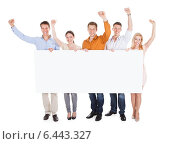 Excited Young Friends Holding Blank Billboard. Стоковое фото, фотограф Андрей Попов / Фотобанк Лори