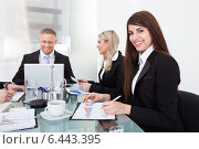 Купить «Businesswoman Sitting With Colleagues In Meeting», фото № 6443395, снято 30 марта 2014 г. (c) Андрей Попов / Фотобанк Лори