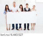 Confident Businesspeople Holding Blank Billboard. Стоковое фото, фотограф Андрей Попов / Фотобанк Лори