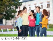 Купить «group of smiling teenagers over campus background», фото № 6444451, снято 22 июня 2014 г. (c) Syda Productions / Фотобанк Лори