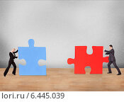 Купить «Group of business people assembling puzzle», фото № 6445039, снято 22 апреля 2012 г. (c) Андрей Попов / Фотобанк Лори