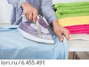 Купить «Midsection Of Woman Ironing Shirt», фото № 6455491, снято 12 июня 2014 г. (c) Андрей Попов / Фотобанк Лори