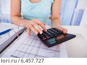 Купить «Woman Calculating Home Finances At Desk», фото № 6457727, снято 31 мая 2014 г. (c) Андрей Попов / Фотобанк Лори