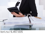 Купить «Accountant Calculating Tax», фото № 6457835, снято 15 марта 2014 г. (c) Андрей Попов / Фотобанк Лори