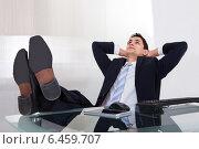 Купить «Relaxed Businessman Daydreaming In Office», фото № 6459707, снято 10 апреля 2014 г. (c) Андрей Попов / Фотобанк Лори